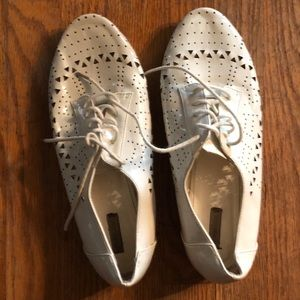 Patent leather laser-cut oxfords